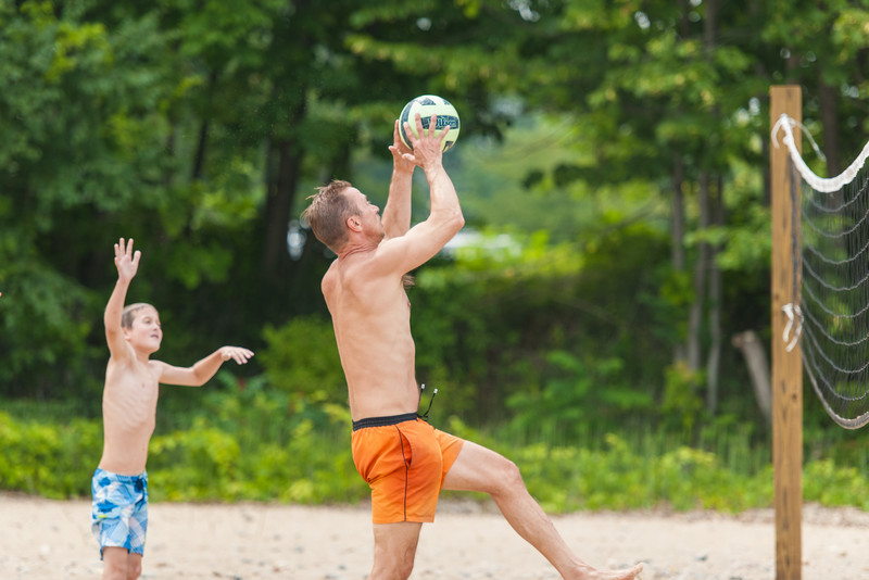 Jack and Paul playing catch it throw it back volleyball.