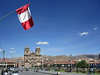 DAY 1: Flag of Peru flies over the Central Plaza de Armas, Cusco, Peru.
