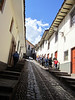 Steep cobblestone street in Cusco.