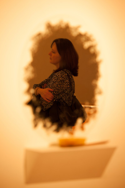 A friend named Patty reflected in a piece of artwork, a handmade mirror