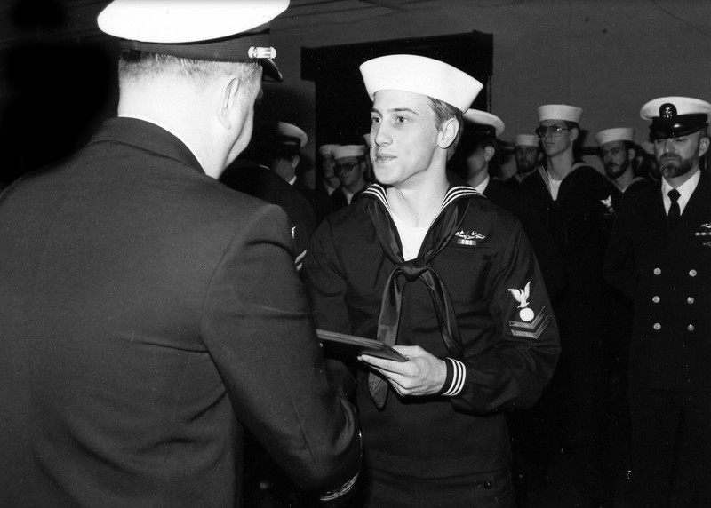 Receiving a commendation from the Commanding Officer of the USS Bergall.  1982.