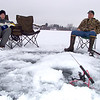Eric and Dave ice fishing on Elk Lake, Attica, Michigan.  Winter, 2003.