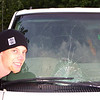 While riding an electric scooter, Eric slammed face first into windshield of this van.  July 27, 2003.
