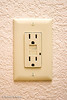 Electrical outlet with ground fault circuit interrupter, USA