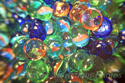 Up and Away 2011-02-18  A departure for me.  The day was so blah that I didn't go outside.  I have only rarely taken indoor shots.  These are some glass balls/stones my wife keeps in a jar.  I tried several ways of shooting them - this is the best of the bunch imo - sharp and a bit dynamic, but I'll have to keep practicing.  Thanks for all the comments in the last few days.