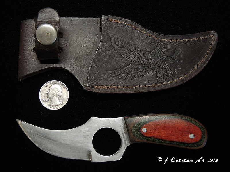 Cat Skinner....probably by Frost Cutlery.