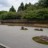 The dry landscape garden of Ryoan-ji Temple dates from mid-15th century.   The 15 rocks grouped on white  raked gravel invite contemplation and the garden is considered by many to be the ultimate expression of Zen Buddhism.