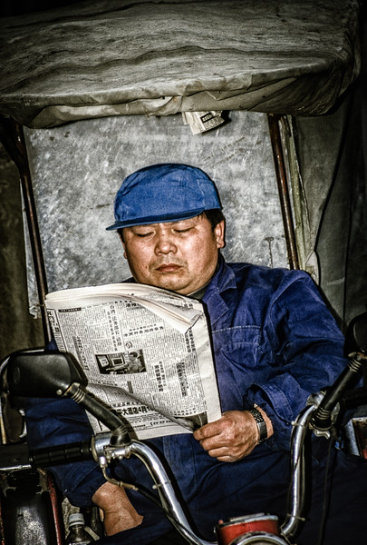 Rickshaw Driver With Newspaper, Nanjing Road, Shanghai