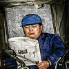 Rickshaw Driver With Newspaper, Nanjing Road, Shanghai