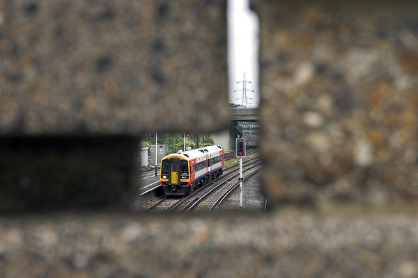 158886 seen through Millbrook Station's concrete footbridge, 20/8/2008
