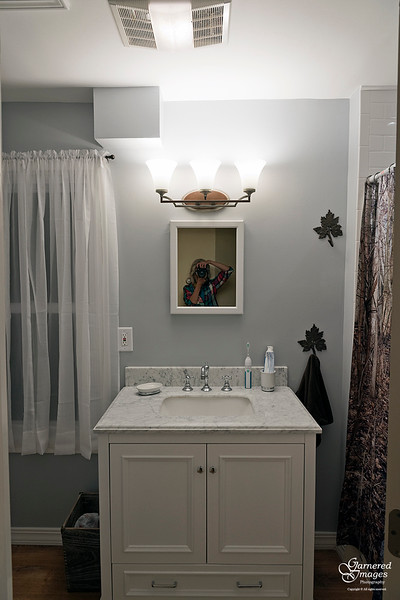 September 23, 2018:  Second floor bathroom after.  Bright new vanity!