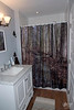 September 23, 2018:  Second floor bathroom after.  I love this floor; the shower curtain is custom-made from a photograph of our woods when they flood.