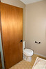 July 30, 2018:  Second floor bathroom before.  Yes, the bathroom door opens onto the toilet.  And because of the unevenness, it is ALWAYS open onto the toilet.