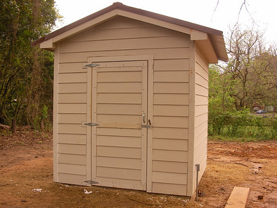 09 03-31 Storage shed complete. Good job! mc