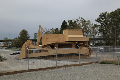 Prototype  An oversized bulldozer made of wood. Not sure what's up with that.