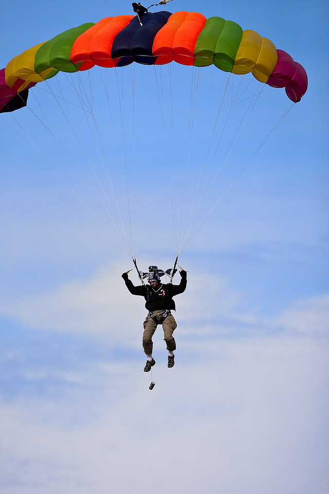 24 October 2009: A skydiver floats towards the field prior to the Oklahoma Sooners 35-13 win over the Kansas Jayhawks at Memorial Stadium in Lawrence, Kansas.
