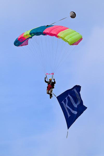 24 October 2009: A skydiver carrying the KU flag floats toward the field prior to the Oklahoma Sooners 35-13 win over the Kansas Jayhawks at Memorial Stadium in Lawrence, Kansas.