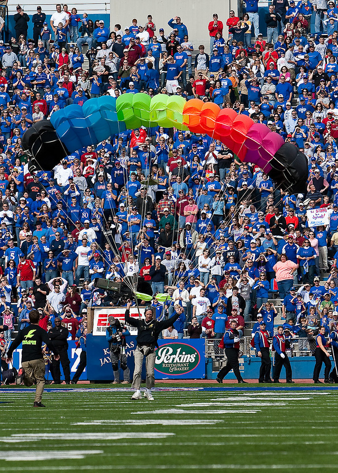 24 October 2009: A skydiver lands on the field prior to the Oklahoma Sooners 35-13 win over the Kansas Jayhawks at Memorial Stadium in Lawrence, Kansas.