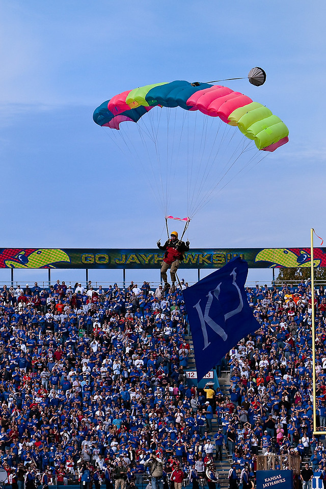 24 October 2009: A skydiver carrying the KU flag enters the stadium prior to the Oklahoma Sooners 35-13 win over the Kansas Jayhawks at Memorial Stadium in Lawrence, Kansas.