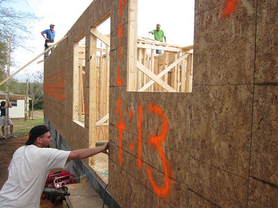 Tim DuBois (left, top) and Charlie Thell (right, top) wait for trusses to be handed up by students.
