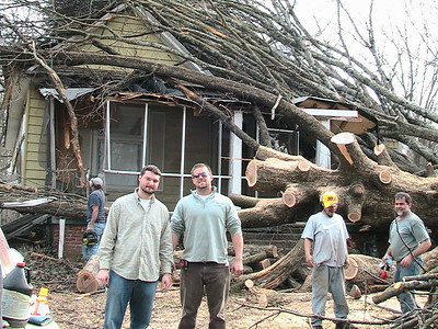 08 03-17 Atlanta, GA - Students help remove fallen trees from homes after severe tornado. ri