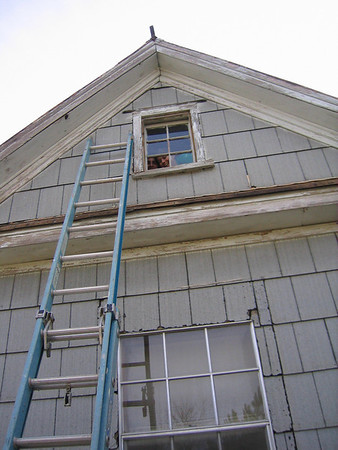 08 02 Students repair broken window in attic of Hamm house to keep out rain, cool weather and insects. lf