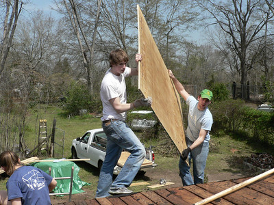 08 03-22 Americus, GA - New plyboard going down over old wood on roof. cd