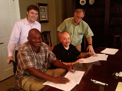 10 06-30 It's official! Thad Harris and Chuck Davis sign mortgages...just in time for the first homebuyers tax credit.