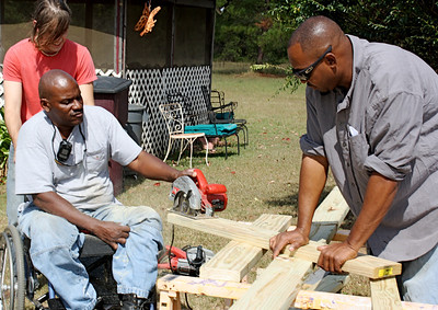 Thad Harris runs the saw at a Fuller Center Faith in Action project.