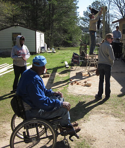 Thad Harris supervises a Student Builders group from Davidson College as students repair a home in Andersonville, Ga.