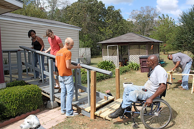Thad Harris is pleased to see a wheelchair ramp repaired for a fellow Sumter County resident.
