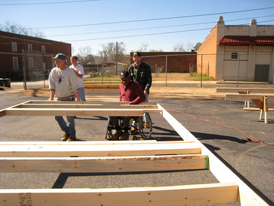 Thad Harris helps build walls for his new home.