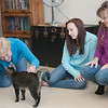Pam, Taylor, and Louise with Eli, the F cat