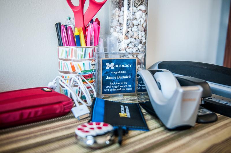 Jamie's desk, including one of her many academic awards