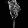Air pistol fired at champagne glass, 5ms after impact.