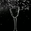 Air pistol fired at champagne glass, 20ms after impact.