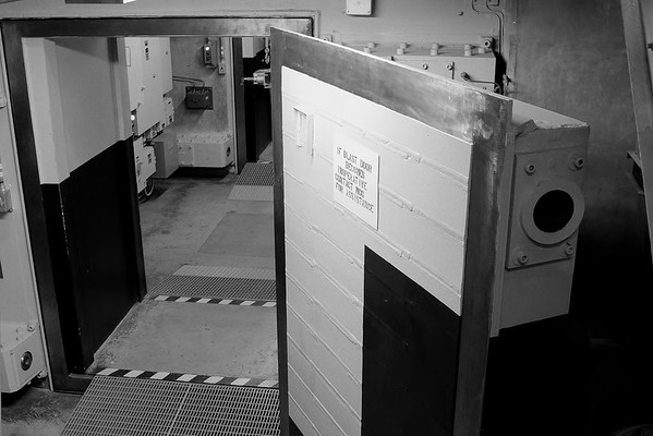 "A view of ""Blast Door 6"", one of the entrances into the missile silo.  The door itself is about a foot thick, and if you look at the doorway you can see that the wall is about 3 feet thick."