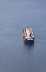 A cargo ship anchored in English Bay.