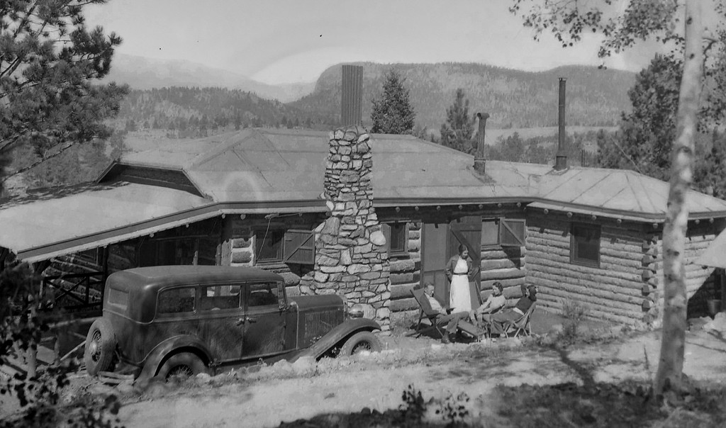 Exterior shot of the same cabin seen elsewhere in this gallery. Car looks like a '31 Ford. . I would love to know where this is. That mountain in the background is pretty distinctive.