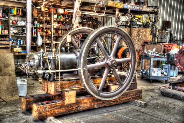 Antique Engine<br /> <br /> I have no idea what type of engine this is, but wanted to take an hdr image of it inside the shop of a farmer.  He likes to tinker with engines during the off season.