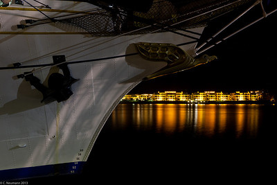 "Bow and figurehead of the barque ""Gorch Fock"" at the night skyline of Warnemünde"