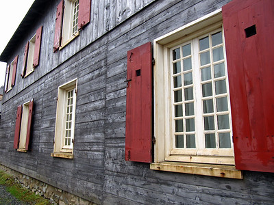 Red shuttered windows at the Fortress of Louisbourg, Nova Scotia