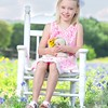 Girl on a White Chair in Bluebonnets.