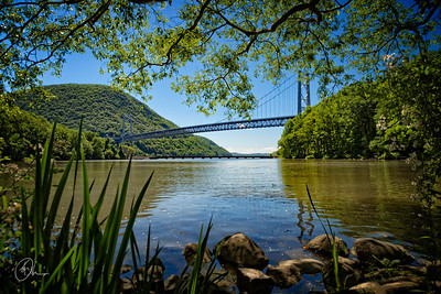 Ground level view of the Hudson River, and Bear Mountain Bridge in New York state.