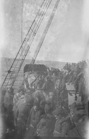 I have no idea about this photo. Looks like soldiers and the rigging on the ship should date it approximately, but I'm not an expert on uniforms or military transport :) Msg me if you have info.
