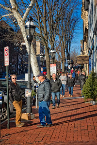 People on the sidewalk near shops on Main Street in Bethlehem, Pennsylvania