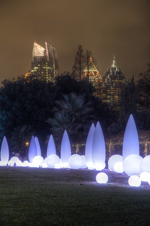 Some of the lights of the Atlanta Botanical Garden's Light show from 2013.  The Atlanta skyline is off in the Background.