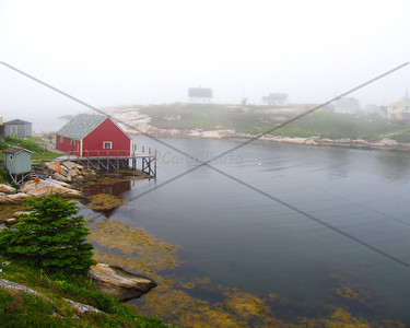 Foggy sky, red house. Peggy's Cove, Nova Scotia