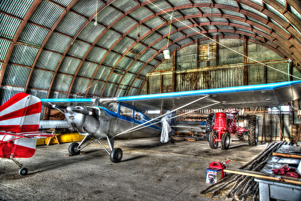 Airplanes and Tractors<br /> <br /> I took this image in the hanger building on a farm.  I loved the colors.