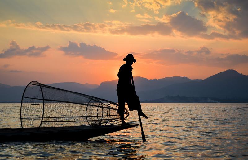 Burmese fisherman on Inle Lake at sunset